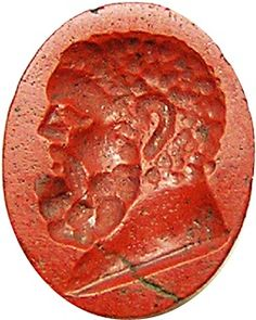 This is a wonderful ancient Roman red jasper intaglio, dating to the 1st - 2nd century A.D. It is boldly sculpted with a portrait of a bearded gentleman, with deep herculean features. It was likely a portrait of the original owner, who paid for his likeness to be cut in miniature by a top gemmarius of the day. Though it could be viewed as an image of Hercules, though he is rarely depicted without a club or lion skin in ancient art. During the 1st and 2nd century A.D. there was a vogue for…