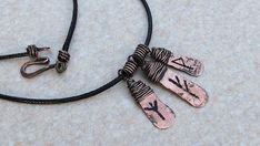 Custom Rune charm necklace , Rune jewelry , Personalized gift , Hand stamped rune necklace , Long necklaces , Popular necklaces , Necklaces for women Norse Rune Necklace. These runes are antique copper. Handmade Norse Rune Necklace made with 10 gauge copper wire hammered with shiny texture for more character and durability. It was tumbled, oxidized and hand polished for more strength and character. They measure 1 inch by 1/2 inch. Necklace options will have a 20 inch long black cord with...