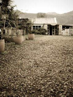 Vanilla Café - Greyton - mimic the country lifestyle you'll find in this picturesque little town. You'll find it at the end of a long pathway, set against the backdrop of Greyton's mountains.  The café specialises in breakfasts and lunches and is fully licensed, in case you like a glass of wine to accompany your meal. 028 254 9453 18 Botha Street Country Lifestyle, Water Systems, Nature Reserve, Mountain Range, Cape Town, Pathways, Lunches, Architecture Design, Backdrops