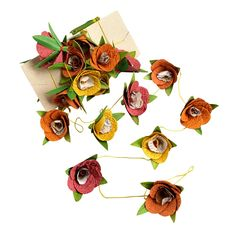 Bright flowers form a summer garland of celebration, in paper and date palm fiber. Summer Celebration Garland, $14