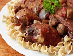 Authentic French Coq Au Vin, a delicious braise of chicken with wine, mushrooms, bacon and onions. This dish is a beloved classic, and for good reason.