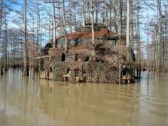 """Duck blind boat house. """"This is from Louisiana. 3 stories- Coon Duck Blind. 1st level hides 4 boats underneath and has room for 2 hunters and has 2 dog doors."""""""