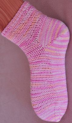 These short summer socks are worked from the top down. The mesh-like pattern is based on a strangely twisted stitch called Veil Stitch from A Treasury of Knitting Patterns by Barbara Walker. The short-row heel uses the PGR method but with added mini-gussets to supply more stitches for the heel.