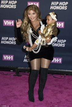 Going to work with mum: Lil' Kim, 39, brought her precious mini-me Royal Reign, two, to the VH1 Hip Hop Honors in New York on Tuesday