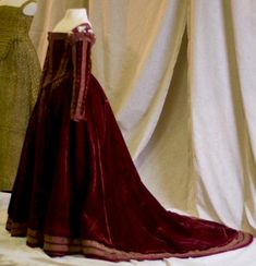 """ca. 1560 Italy, Florence. Believed to be from 1560, this is called the """"Red Dress of Pisa."""" It is a Florentine gown from the sixteenth century - it was found on a wooden effigy at San Matteo. It is housed at the Palazzo Reale di Pisa (Museum Nazionale). It is made of red velvet with gold couched trim."""