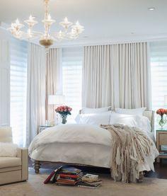 white + chandelier + fluffy pillow