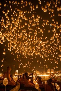 Chinese lanterns instead of balloons at the end of the night?  we light one off every year one for every year already would love to tye it in for the going away.
