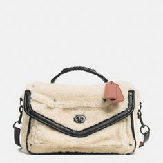 "The Rhyder Messenger In Shearling from Coach (Okay, at first I was like ""wtf?"" Then, I couldn't stop looking at it. Now, I'm like ""This is amazing and I want it. Definitely an acquired taste.)"