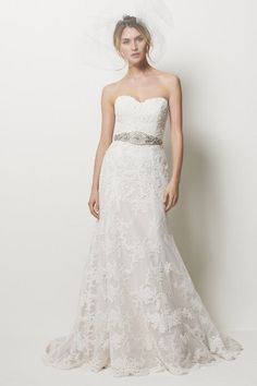 We adore the Swiss Dot detail on this Watters and Watters bridal gown