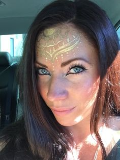 Gold henna inspired face paint by Cynnamon of Bay Area Party Ent. from San Francisco, Ca.