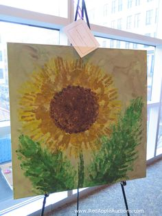Handprint art.  Oh the ways we've all seen it in the school auctions, eh?  I'm partial to sunflowers as it's the Kansas state flower.  #SchoolAuctionClassArt