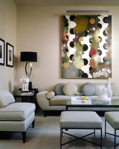 Neutrals with muted colors in the art, I like how the pillows follow the form in the art