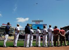 MINNEAPOLIS, MN - MAY 28: The Minnesota Twins look on as planes flyover during the National Anthem before the game against the Oakland Athletics on May 28, 2012 at Target Field in Minneapolis, Minnesota