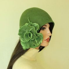 One of a kind, very elegant and light hat in color avocado green made in technique nunofelt. Complete with brooch. Hat-cap style of the 1920s.