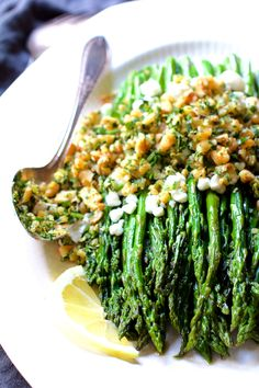 Roasted Asparagus with Goat Cheese and Walnut Lemon Gremolata is a beautiful and tasty way to showcase this springtime jewel!