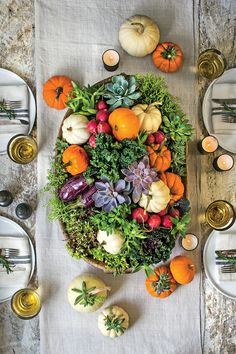 Topped with silver serving pieces, pale gray and green pumpkins add interesting height to your buffet. Materials: heirloom pumpkins with flat tops, small saw, s