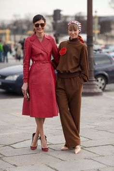 Paris Street Style. Loving the red coat. The brown get up... Not so much lol