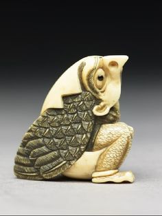 This little century ivory netsuke is in the form of a tengu mountain demon emerging from an egg!
