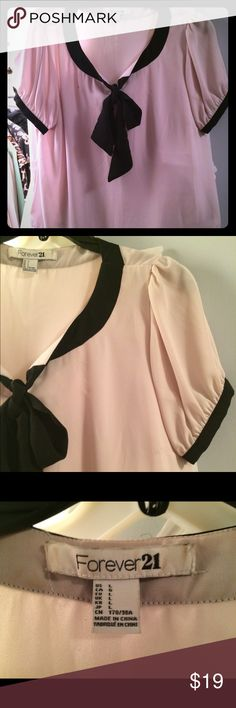 Forever 21 Bow Blouse🌺👛🌺👛 This beautiful timeless blouse has a bow front and buttons on the Pleated sleeves. It's absolutely adorable and the perfect complement dressing up or down. I'm all for that! Beautiful under a blazer or by itself cream and black to die for! Forever 21 Tops Blouses