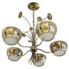 Lightolier Brass Chandelier   From a unique collection of antique and modern chandeliers and pendants  at https://www.1stdibs.com/furniture/lighting/chandeliers-pendant-lights/