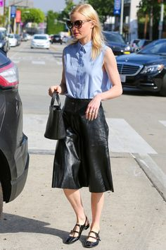 Kate Bosworth wears a sleeveless chambray blouse, a black leather midi skirt, black flats, and a Meli Melo Rosalia mini bag.