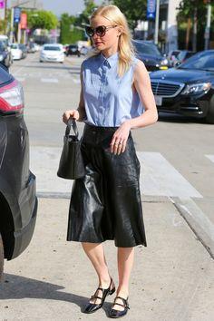 Kate Bosworth wears a sleeveless chambray blouse, a black leather midi skirt, black flats, and a Meli Melo Rosalia mini bag.