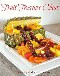 """A pineapple treasure chest filled with fruit, for watching the movie """"National Treasure."""""""