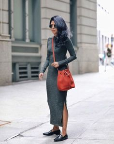 A knit midi dress with a bucket bag and loafers.