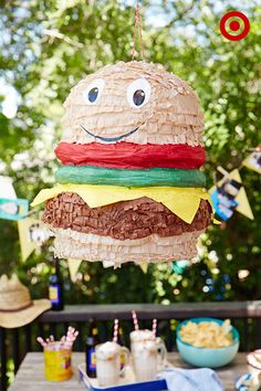 Make a backyard BBQ extra fun with this burger piñata—it can be filled with a mix of sweets or with non-sugary items, like mini toys. Either way, it's a great game for the whole family.