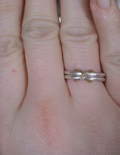 sterling silver wedding ring or commitment ring with 18 karat gold infinity. $245.00, via Etsy.