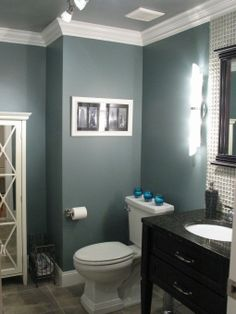 I really like this dark blue/gray color Benjamin Moore Smokestack Gray. @ DIY Home Design.maybe for the kids/guest bathroom