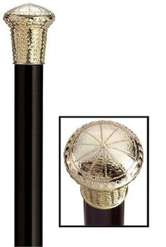 Formal Gold Tone Cap Cane Formal cane with gold tone cap of high impact plastic mounted stylishly on a black hard wood shaft with metal ferrule. The shaft is 36 inches long and tapers from 7/8 inch to