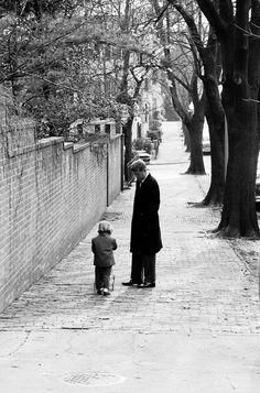 President-elect Kennedy walking with his daughter around their neighbor hood in georgetown.