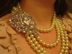 DIY statement necklace. I have all the pieces- several strands of pearls & a gorgeous broach. WANT to do this!!