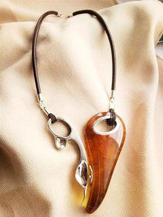 When you see a luscious Baltic amber design like this pendant you know it's from a Polish designer. E&M - Elżbieta i Marek Pawłowscy