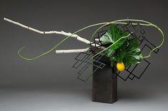 Untitled horizontal flower arrangement with driftwood ~ by Gordon
