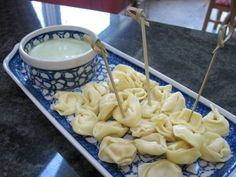 cheese tortellini with lemon basil dip. would be perfect for a summer snack!