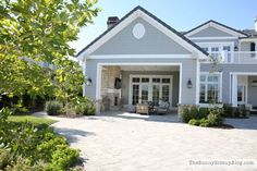Back yard covered porch gives homeowners an additional shaded area for outdoor entertaining