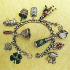 Vintage New Year's Charm Bracelet:  This is a wonderful collection of 13 vintage charms on a charm bracelet to ring in the new year. There are lucky charms, enamels, openers and movers!