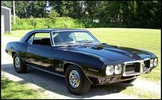 There's my baby...Good grief I really miss this car.  Except mine was Hot Rod Black .... kinda in the middle of matte and glossy.  And I had Amer. Racing wheels.1969 Pontiac Firebird Ram Air IV