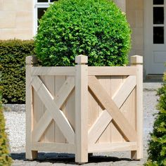 This sturdy and robust planter is designed with prominent cross-braces are made from 10cm timbers and are 2.5 cm thick, which add a beautiful visual distinction to the vertical planks.  It can be made in natural oak or in a tropical hardwood with the option of a custom color. The planter is constructed with 7cm wide corner posts, each topped by a finial, and 13cm wide planking.