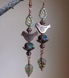Boho dangle earrings with copper swirl bird on variegated