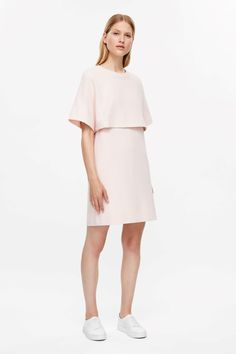 Designed with an overlapping, kimono sleeved layer, this dress is made from cotton jersey with a comfortable stretch. A close-fit, it has a round ribbed neckline and a simple, straight hemline.