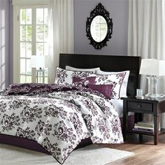 The Leonora collection is updated and versatile for any look you want for your bedroom. A beautiful scroll, floral motif is printed on the front and back of the comforter and sham. The comforter and sham is fully reversible for you to decorate your bed. One side is printed in black and white and the other side is printed with tonal purple colors. The comforter set includes comforter, sham and two decorative pillows.