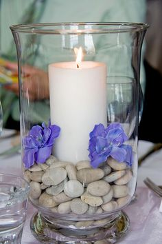 Wedding table center piece, simple and pretty.  Think about re-use.  You can use these at home when the day is over. (minus the dead, rotting flowers)