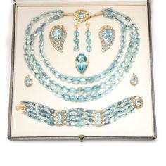 Pat Saling's Seaman Schepps aquamarine suite from the 1950s. Discover the antique and vintage jewellery trend coming up to date: http://www.thejewelleryeditor.com/window-shopping/vintage/pat-salings-mid-century-aquamarine-suite/