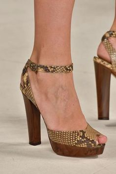 The 50 Best Shoes at NY Fashion Week | StyleCaster RALPH LAUREN: These python sandals paired perfectly with Ralph Lauren's safari themed spring collection. Read more: http://stylecaster.com/the-50-best-shoes-new-york-fashion-week-spring-2015/#ixzz3DAdPQ8XR