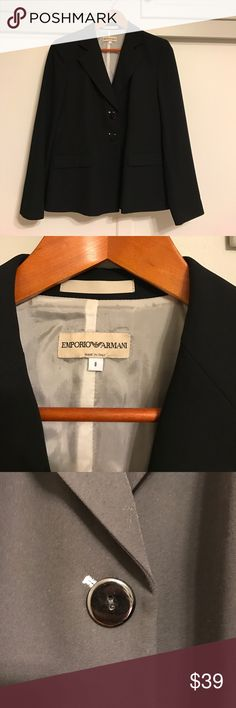 Vintage black Emporio Armani women's blazer size 8 Classic and sophisticated black jacket from Emporio Armani in a size 8.  This piece is 100% wool with a rayon lining.  In perfect condition with the exception of a pencil thin line of something embedded into the fabric.  Only noticeable when the jacket is unbuttoned, it may be something a cleaner can easily remove.  Price is reflective of this very minor issue. Emporio Armani Jackets & Coats Blazers