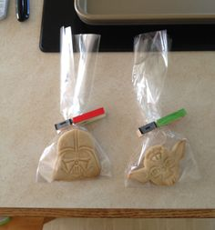 Star Wars cookies with Lightsaber clothes pin clips. I used clothes pins bought at Home Depot and acrylic paint. They were perfect for keeping the bags closed. I painted one side red (for the Siths) and the other green (for the Jedi) so that each child had both lightsabers.