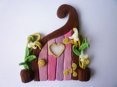 fimo fairy door. Cud make one and stick to skirting board.